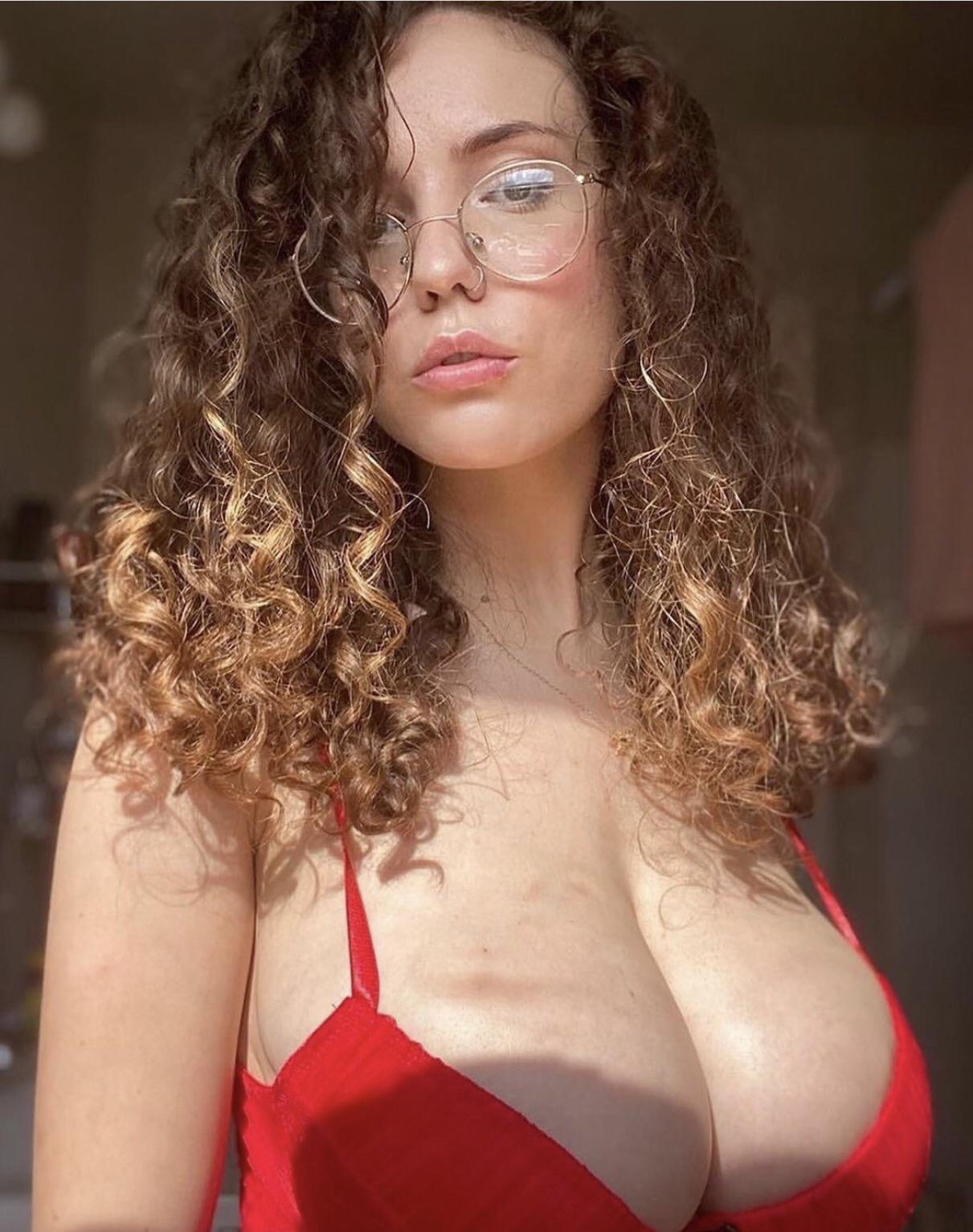 Long curly hair on big tits masturbating slut