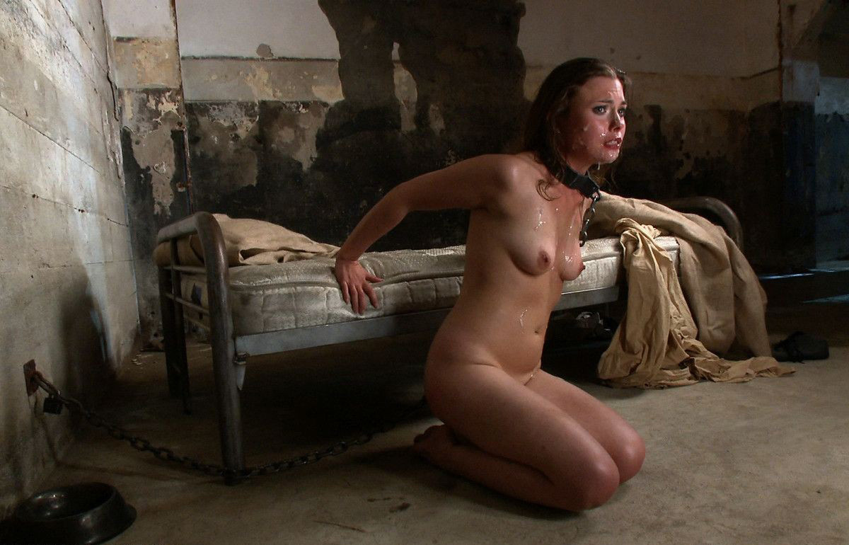 Girl is chained up in a dungeon and kept as a sex slave by pervert