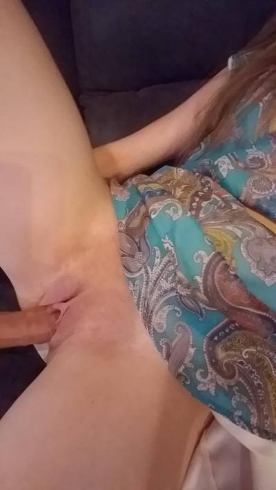 Tightly around a dildo in a turquoise dress.