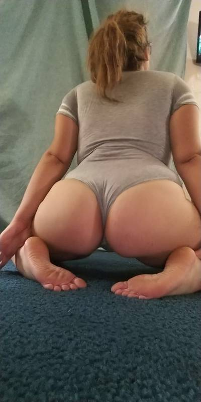 big booty, nerdy chick with cute feet in a gray onesie :)